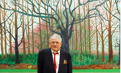 David Hockney stands in front of a recent painting