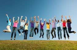 healthy young people jumping on a hilltop
